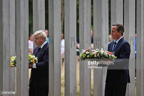 British Prime Minister David Cameron and London Mayor Boris Johnson lay a wreath at the 7/7 Memorial in Hyde Park on July 7 2015 in London England...
