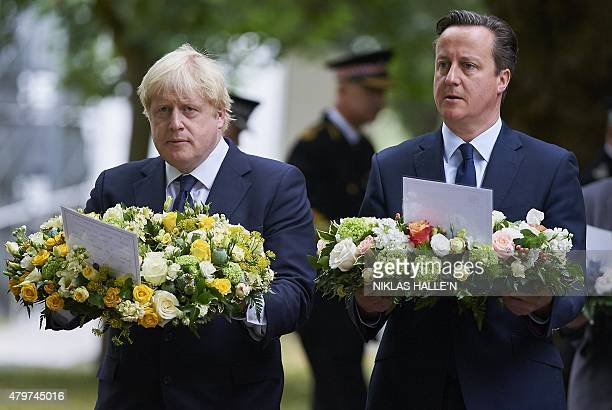 British Prime Minister David Cameron and London Mayor Boris Johnson take part in a wreath laying ceremony in London's Hyde Park on July 7 in memory...