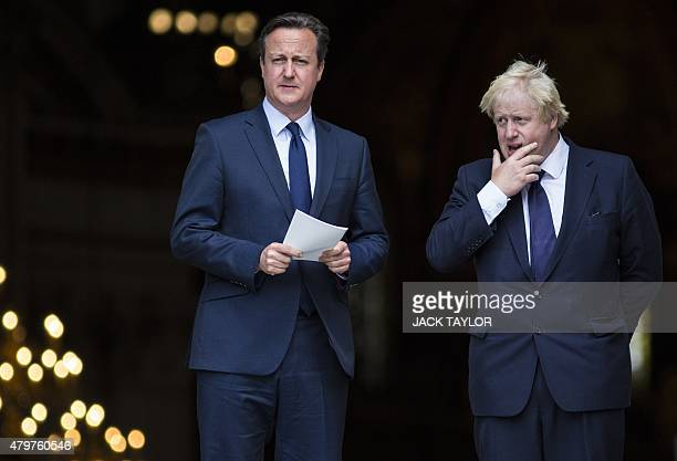 British Prime Minister David Cameron and London Mayor Boris Johnson leave St Paul's Cathedral in central London on July 7 2015 after attending a...