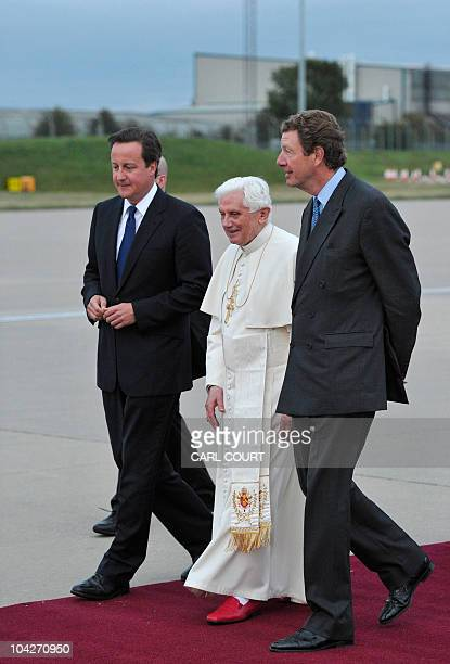 British Prime Minister David Cameron and Lord Chamberlain Earl Peel escort Pope Benedict XVI as he prepares to leave from Birmingham International...