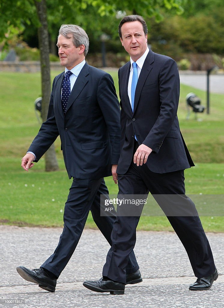 British Prime Minister David Cameron (R) and Northern Ireland Secretary, Owen Paterson, arrive for a meeting with Northern Ireland's First Minister, and Deputy First Minister at Stormont Castle in Belfast, Northern Ireland May 20, 2010. Cameron and his coalition deputy unveiled full details Thursday of their 'historic' power-sharing deal, under growing scrutiny for signs of strain. AFP PHOTO/Peter Muhly