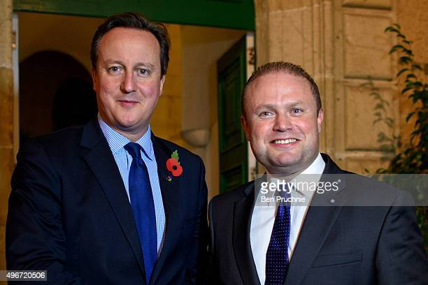 British Prime Minister David Cameron and Prime Minister of Malta Joseph Muscat talk after the first session of the Valletta Summit on migration on...