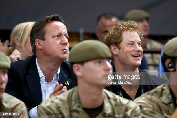 British Prime Minister David Cameron and Prince Harry watch the wheelchair basketball at the Copperbox during Day Two of the Invictus Games at the...