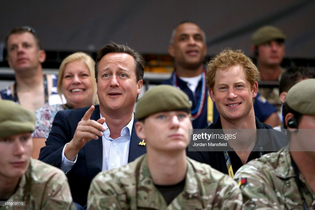 British Prime Minister David Cameron and Prince Harry watch the wheelchair basketball at the Copperbox during Day Two of the Invictus Games at the Olympic Park on September 12, 2014 in London, England.