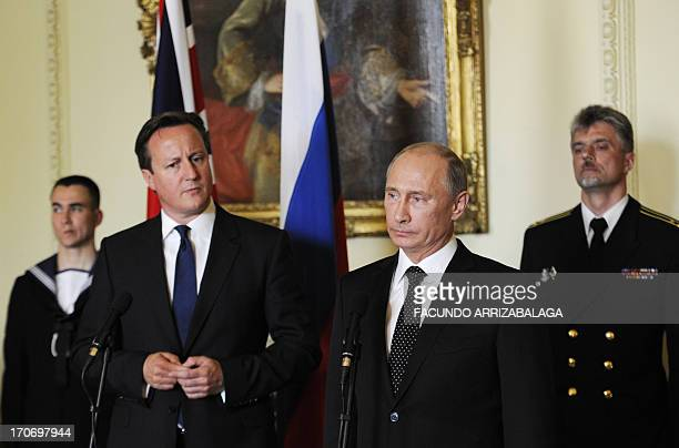 British Prime Minister David Cameron and Russian President Vladimir Putin speak during a ceremony awarding the Russian Ushakov medal to WWII Arctic...