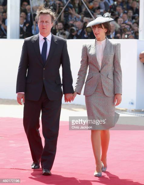 British Prime Minister David Cameron and Samantha Cameron arrives for a Ceremony to Commemorate DDay 70 on Sword Beach on June 6 2014 in Ouistreham...