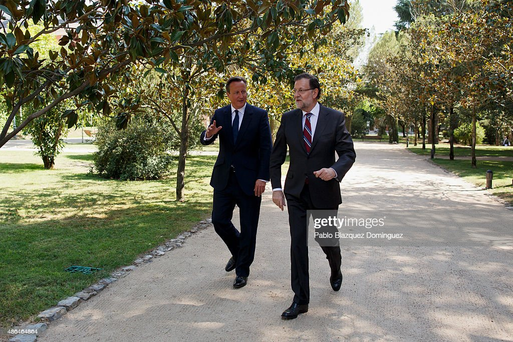 British Prime Minister David Cameron (L) and Spanish Prime Minister Mariano Rajoy (R) walk in front of the media along the gardens of Moncloa Palace on September 4, 2015 in Madrid, Spain. David Cameron is visiting Spain and Portugal as part of a tour to seek for support from fellow European leaders to go along with a renegotiation of Britain's EU membership. Rajoy and Cameron are also expect to talk about the refugees crisis the European Union is facing.