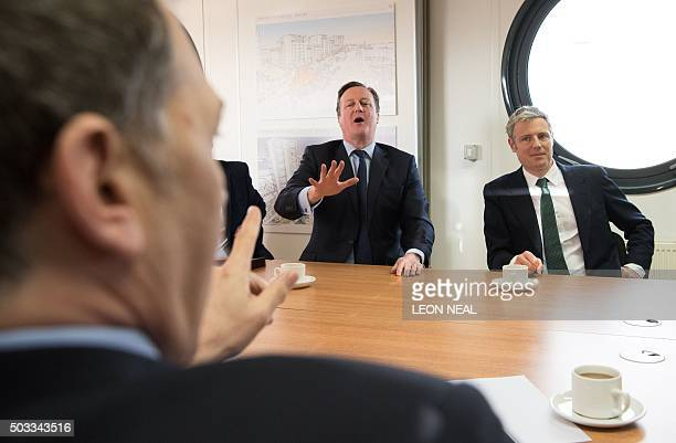 British Prime Minister David Cameron and the Conservative party London mayoral candidate Zac Goldsmith attend a meeting with Bellway executives on...