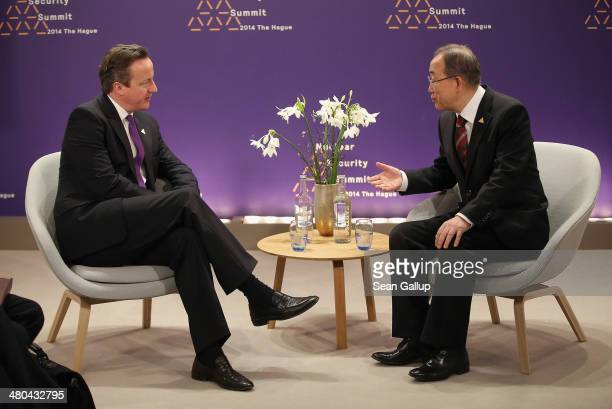 British Prime Minister David Cameron and UN Secretary General Ban Kimoon speak with one another during bilateral talks at the 2014 Nuclear Security...