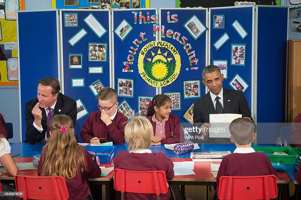 British Prime Minister David Cameron and US President Barack Obama meet school children at Mount Pleasant Primary School prior to the NATO summit on September 4, 2014 in Newport, Wales. Leaders and senior ministers from around 60 countries are meeting at what has been billed as the most important NATO summit since the end of the cold war with the situation in Ukraine and the threat of ISIS likely to be top of the agenda.