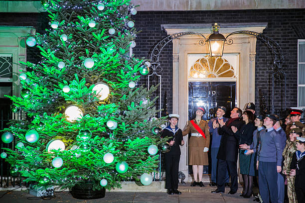 British Prime Minister David Cameron and wife Samantha Cameron join  military and their families at the - The British Christmas Tree Association Deliver Their Winning Tree To