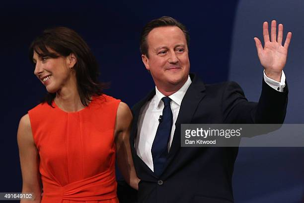British Prime Minister David Cameron and wife Samantha Cameron stand on stage after Mr Cameron's keynote speech on the fourth and final day of the...