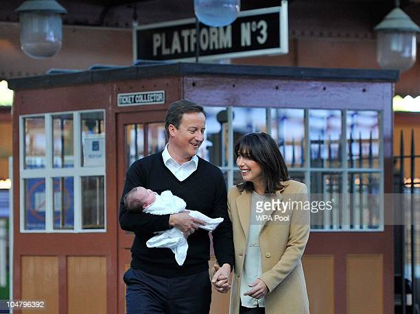 British Prime Minister David Cameron and wife Samantha with their baby daughter Florence Rose Endellion at Birmingham Moor Station on October 5 2010...