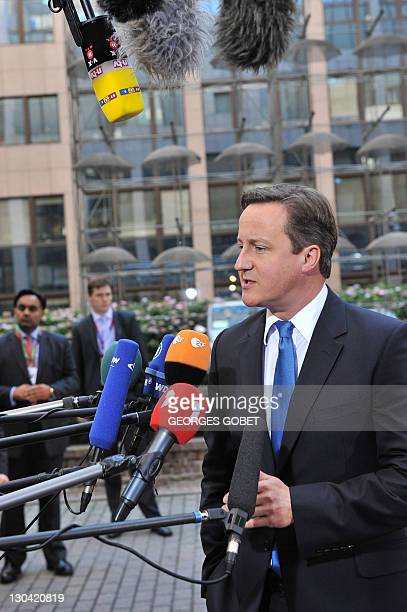 British Prime Minister David Cameron answers media as he arrives prior to an European Council at the Justus Lipsius building, EU headquarters in...