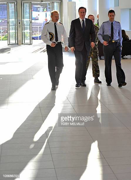British Prime Minister David Cameron arrives at The Permanent Joint Headquarters in Northwood north of London on October 19 2010 Britain is to scrap...