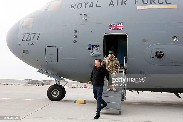 British Prime Minister David Cameron arrives for a visit at Camp Bastion outside Lashkar Gah on December 20 2012 in Helmand Province Afghanistan...