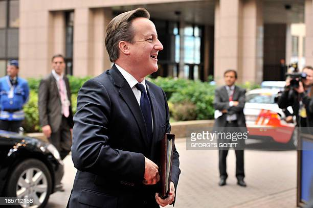 British Prime Minister David Cameron arrives on October 24 2013 to attend a European Council meeting at the EU headquarters in Brussels European...
