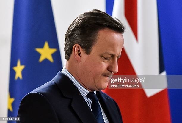 British Prime minister David Cameron arrives to give a press conference during a European Union summit on June 28, 2016 at the EU headquarters in...