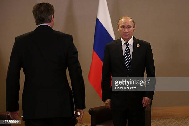 British Prime Minister David Cameron arrives to meet Russian President Vladimir Putin during their bilateral meeting on day two of the G20 Turkey...