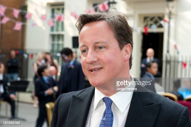 British Prime Minister David Cameron attends the Royal Wedding Street Party at 10 Downing Street on April 29 2011 in London England