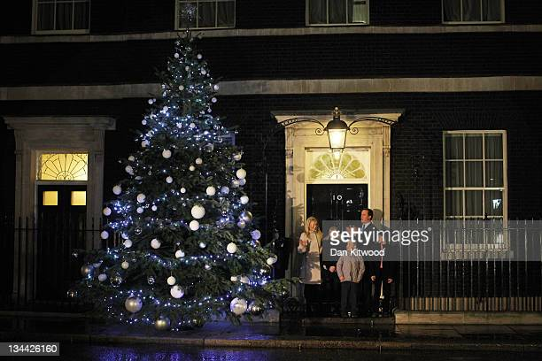 British Prime Minister David Cameron Blue Peter presenter Helen Skelton and Blue Peter Badge winners turn on the Christmas tree lights at 10 Downing...