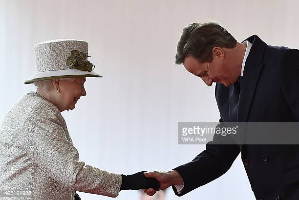 British Prime Minister David Cameron bows as he greets Queen Elizabeth II during a ceremonial welcome for the State Visit of The President of The...