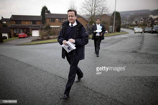 British Prime Minister David Cameron campaigns with local candidate Kashif Ali in the Shaw area at Oldham East and Saddleworth northwest England on...