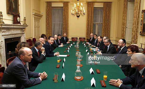 British Prime Minister David Cameron chairs a meeting of the Holocaust Commission prior to a reception for survivors of the Holocaust to commemorate...