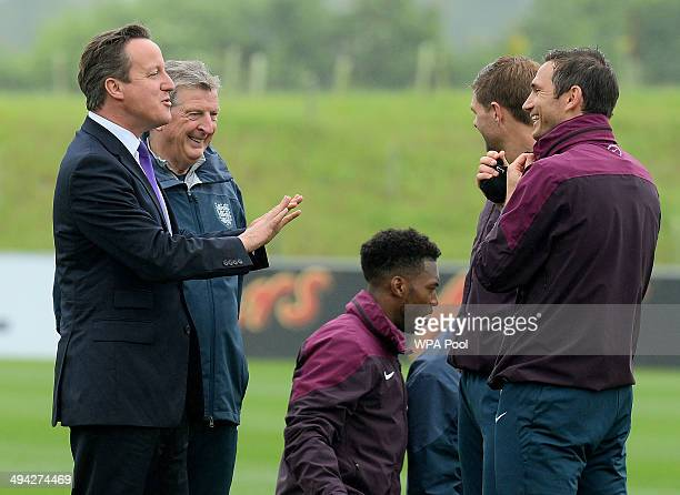 British Prime Minister David Cameron chats with England football manager Roy Hodgson Steven Gerrard and Frank Lampard during his visit to England's...