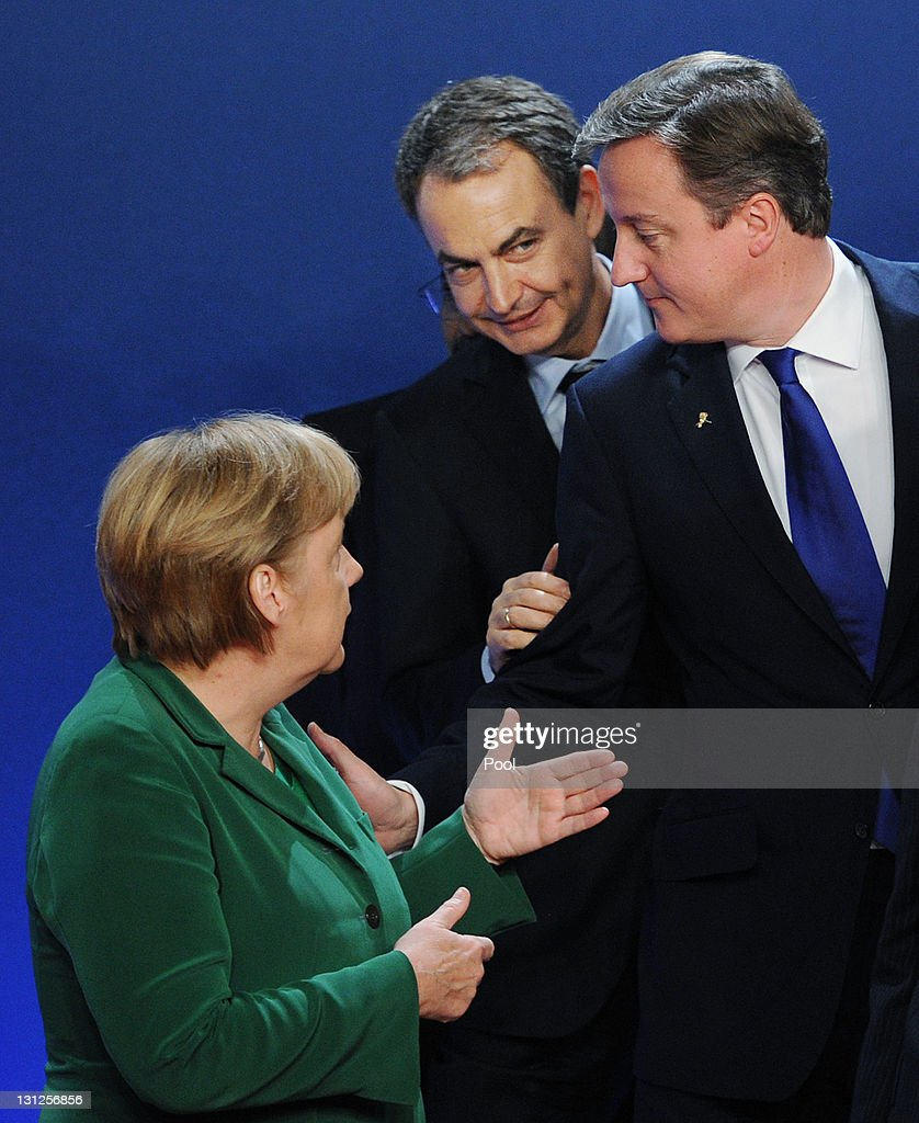 British Prime Minister David Cameron chats with German Chancellor Angela Merkel and Spanish Prime Minister Jose Luis Zapatero (C) at a photo session at the G20 Summit on November 3, 2011 in Cannes, France. World's top economic leaders are attending the G20 summit in Cannes on November 3rd and 4th, and are expected to debate current issues surrounding the global financial system in the hope of fending off a global recession and finding an answer to the Eurozone crisis.