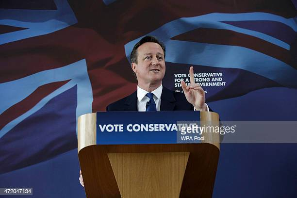 British Prime Minister David Cameron delivers a speech at the Ambleside Sports Club on May 3 2015 in Nuneaton England Britain goes to the polls in a...