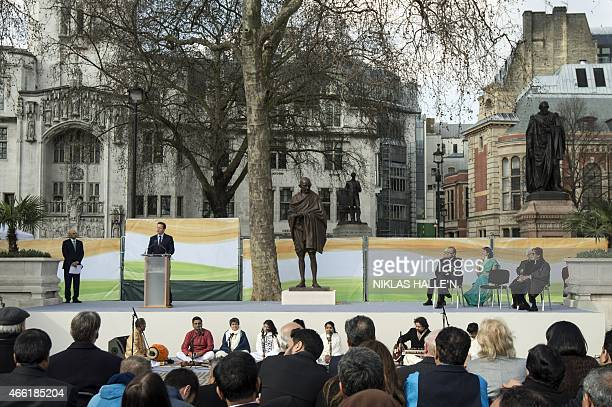 British Prime Minister David Cameron delivers a speech during a ceremony unveiling a statue of Mahatma Gandhi in Parliament square in central London...