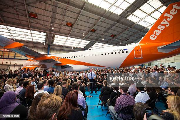 British Prime Minister David Cameron delivers a speech to easyJet employees at the aviation company's Luton Airport Hangar on May 24 2016 in Luton...