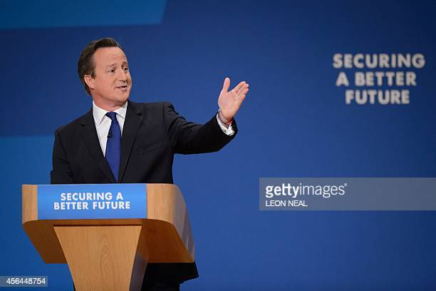 British Prime Minister David Cameron delivers his keynote speech on the final day of the annual Conservative Party Conference in Birmingham central...