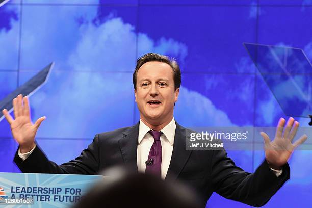 British Prime Minister David Cameron delivers his keynote speech to delegates at the annual Conservative Party Conference at Manchester Central on...