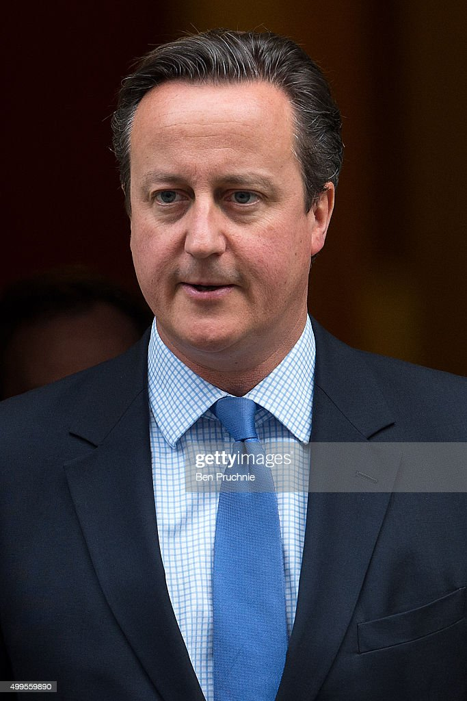 British Prime Minister David Cameron departs Number 10 Downing Street on December 2, 2015 in London, England. British MPs are expected to vote tonight on whether to back UK airstrikes on Islamic State targets in Syria, following a 10-hour long House of Commons debate.