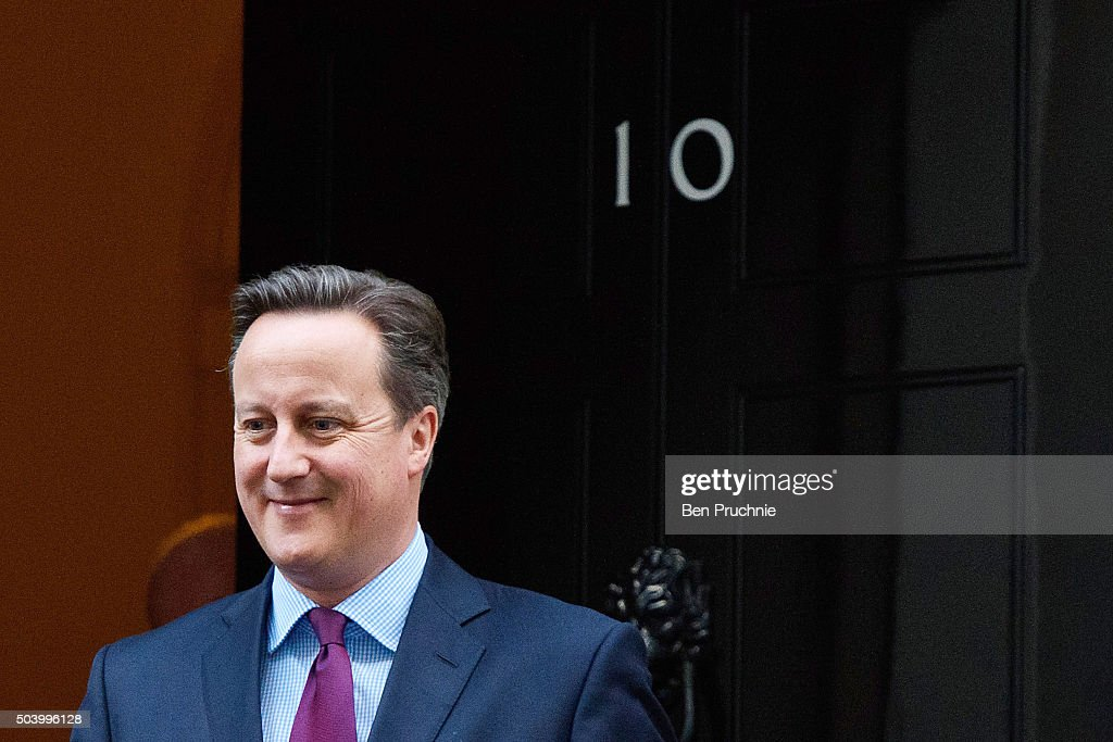 British Prime Minister David Cameron departs Number 10 Downing Street to meet Queen Rania of Jordan on January 8, 2016 in London, England. The Prime Minister held talks with Queen Rania of Jordan today, discussing the need for a comprehensive approach to the Syrian humanitarian crisis and how to implement education and employment for refugees, to enable them to return to Syria and rebuild its economy in the future.