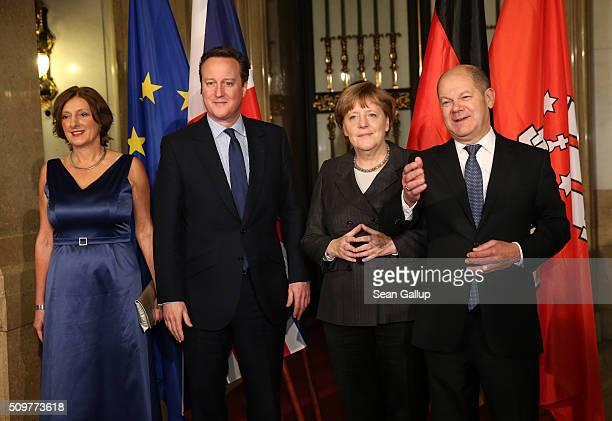 British Prime Minister David Cameron German Chancellor Angela Merkel Hamburg's Mayor Olaf Scholz and his wife Britta Ernst attend the annual...