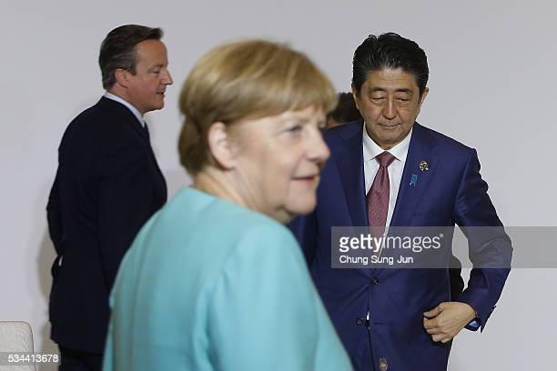 British Prime Minister David Cameron German Chancellor Angela Merkel and Japanese Prime Minister Shinzo Abe attend the Japan EU EPA/FTA meeting on...