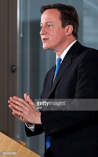 British Prime Minister David Cameron gestures as he delivers a speech on higher education funding in central London on December 8 2010 England AFP...