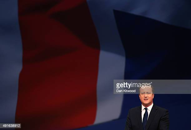 British Prime Minister David Cameron gives his keynote speech to delegates on the fourth and final day of the Conservative Party Conference at...