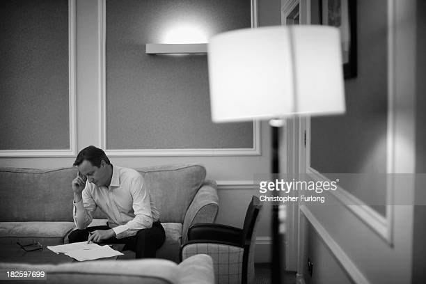 British Prime Minister David Cameron goes through the final details of his keynote speech before delivering it to party members tomorrow at...