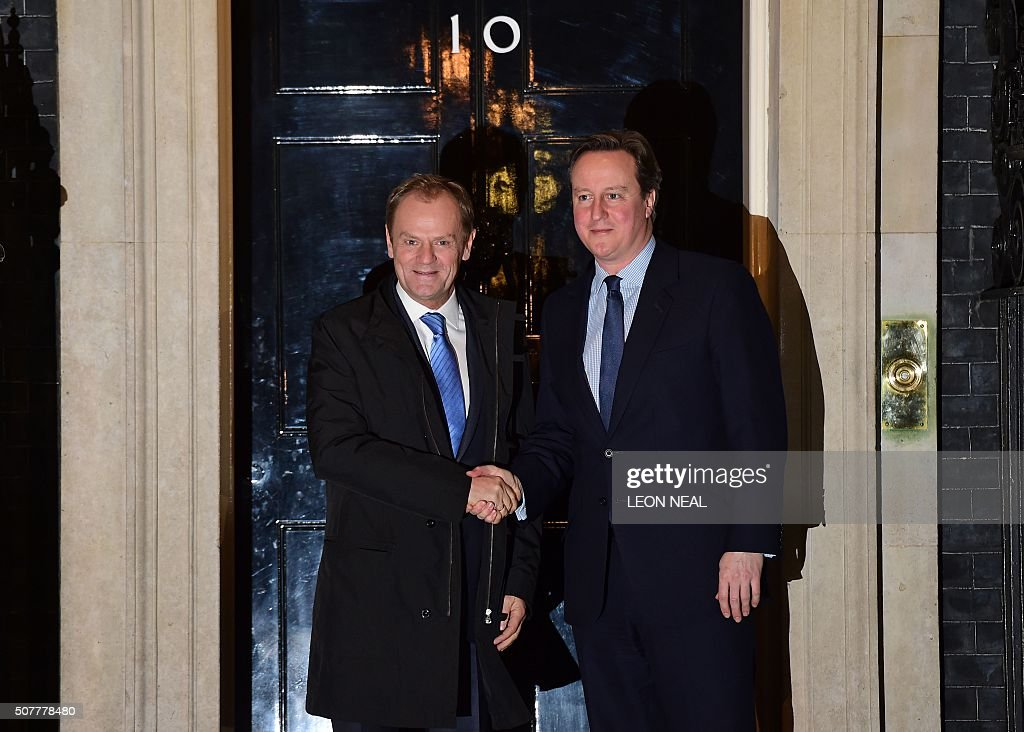 British Prime Minister David Cameron (R) greets European Council President Donald Tusk outside No 10 Downing Street in central London on January 31, 2016, ahead of their meeting. Prime Minister David Cameron is to propose curbing the benefits European Union migrants can claim in negotiations with EU president Donald Tusk ahead of a referendum on whether Britain should leave the bloc. Under Cameron's proposal, an 'emergency brake' to in-work benefits would come into force immediately after the referendum, due to be held by 2017. / AFP / Leon Neal