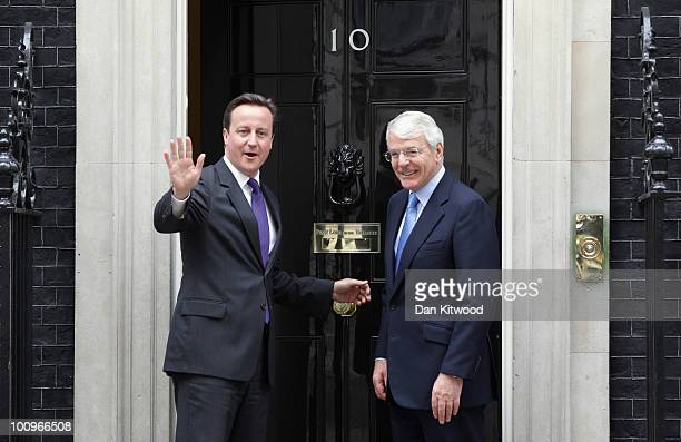 British Prime Minister David Cameron greets former British Prime Minister Sir John Major for talks at 10 Downing Street on May 26 2010 in London...
