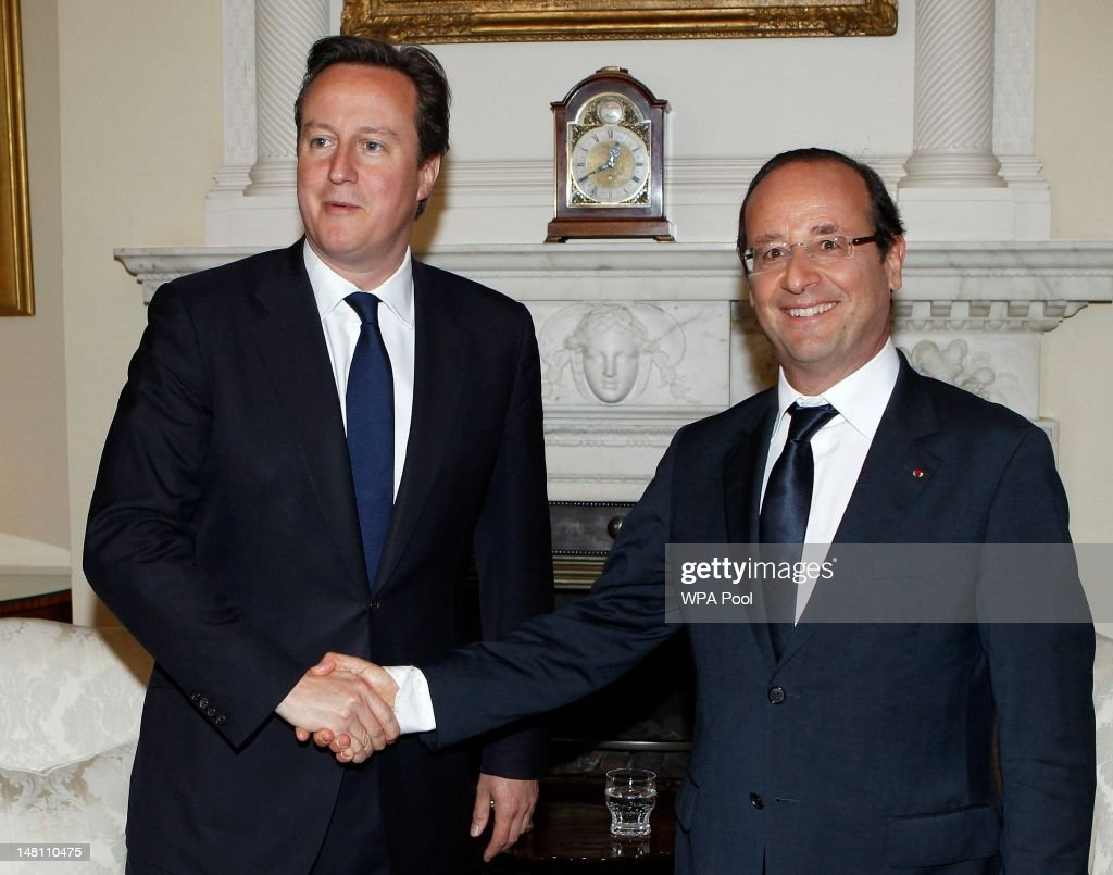 British Prime Minister David Cameron (L) greets French President Francois Hollande in the White Room at Number 10 Downing Street on July 10, 2012 in London, England. This is the French President's first official visit to the United Kingdom since taking office, during which he will attend meetings with British Prime Minister David Cameron and Queen Elizabeth II.