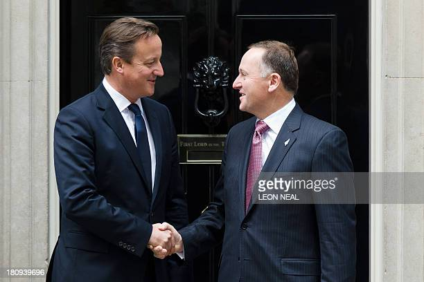 British Prime Minister David Cameron greets his New Zealand counterpart John Key ahead of a meeting in Downing Street central London on September 18...