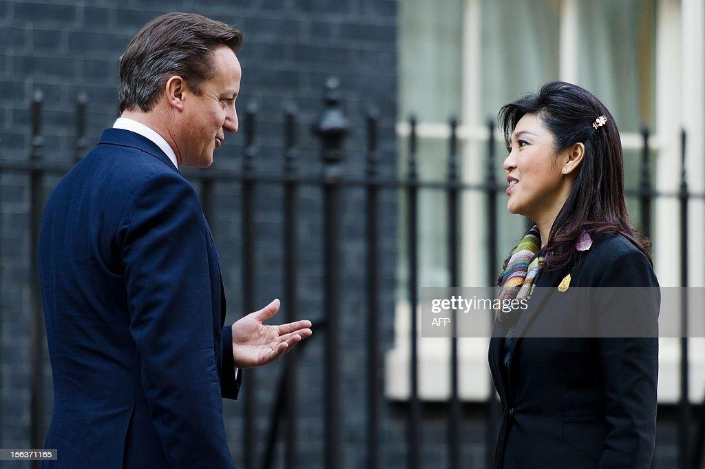 British Prime Minister David Cameron (L) greets his Thai counterpart Yingluck Shinawatra on the steps of number 10, Downing Street in central London on November 14, 2012. Yingluck Shinawatra is on an official visit to Britain during which she has met with Queen Elizabeth II and Prime Minister David Cameron.