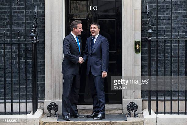 British Prime Minister David Cameron greets Italian Prime Minister Matteo Renzi as he arrives in Downing Street on April 1 2014 in London England Mr...