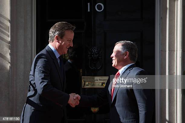 British Prime Minister David Cameron greets King Abdullah II of Jordan at Downing Street on June 23 2015 in London England The King is visiting...