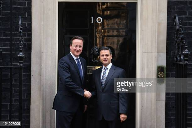 British Prime Minister David Cameron greets Mexican Presidentelect Enrique Pena Nieto outside Number 10 Downing Street on October 16 2012 in London...